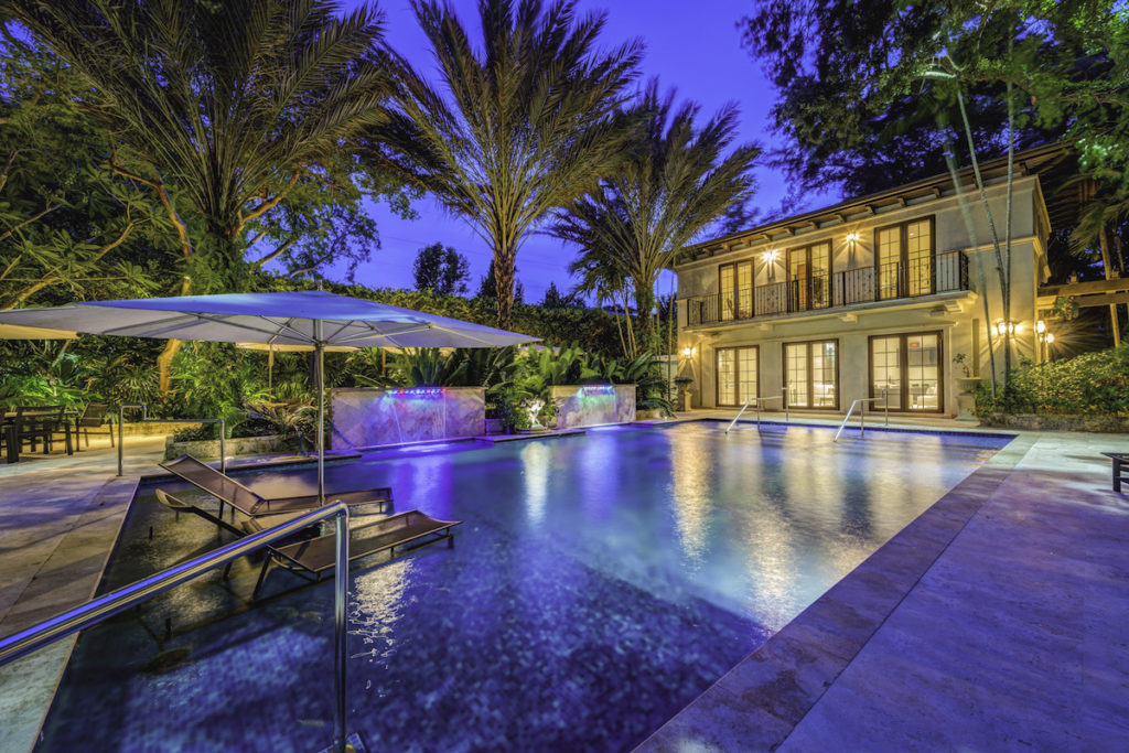 3 tropical mansions for sale in a class of their own for Koi pond builders tampa